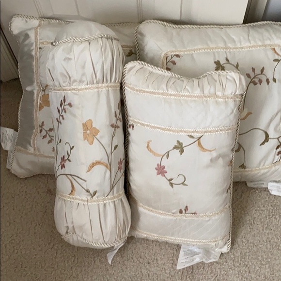 Decorative throw pillows for a bed